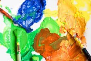 Blue-green-orange-yellow paint-paintbrushes