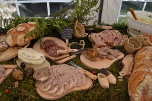 Various charcuterie dishes on wooden trays